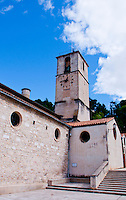 Side facade of a church and tower in Chateaurenard, Provence, France.