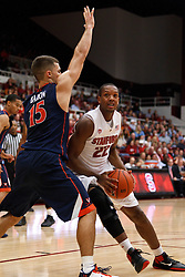 November 18, 2010; Stanford, CA, USA;  Stanford Cardinal guard Jarrett Mann (22) is guarded by Virginia Cavaliers guard Billy Baron (15) during the first half at Maples Pavilion.