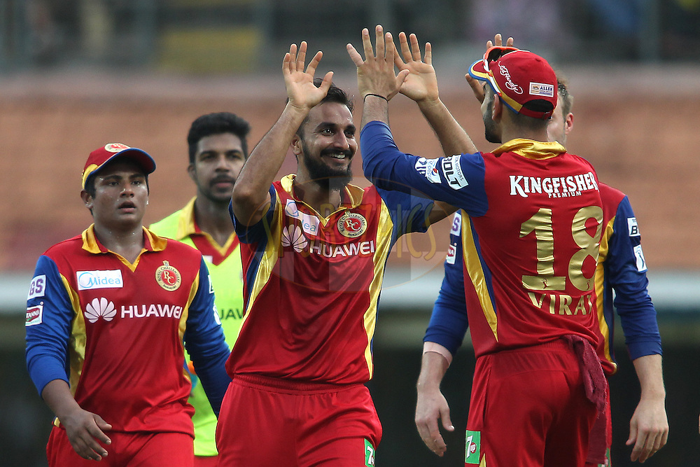 Harshal Patel of the Royal Challengers Bangalore is congratulated by Royal Challengers Bangalore captain Virat Kohli for getting Suresh Raina of Chennai Super Kings wicket during match 37 of the Pepsi IPL 2015 (Indian Premier League) between The Chennai Superkings and The Royal Challengers Bangalore held at the M. A. Chidambaram Stadium, Chennai Stadium in Chennai, India on the 4th May April 2015.<br /> <br /> Photo by:  Shaun Roy / SPORTZPICS / IPL