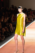 A shiny yellow-green sleeveless  mini-dress.