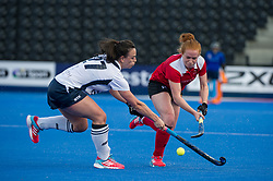 Holcombe's Sarah Jones is tackled by Xenna Hughes of East Grinstead. East Grinstead v Holcombe - Semi-Final - Investec Women's Hockey League Finals, Lee Valley Hockey & Tennis Centre, London, UK on 22 April 2017. Photo: Simon Parker