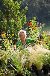 Carol Klein arranging plants in the nursery at Glebe Cottage