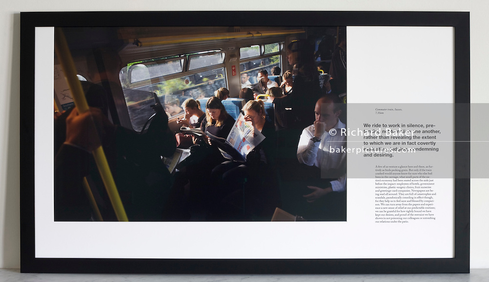 Rush hour train commuters on-board carriages traveling into central London. <br /> <br /> A limited edition (1 of 6) Lambda digital framed print created for the Werk Nu (Work Now) exhibition at the Z33 Gallery in Hasselt, Belgium and including specially selected text by Alain de Botton from his 'The Pleasures and Sorrows of Work' book (Hamish Hamilton, 2009). <br /> <br /> The photograph is the copyright Richard Baker. The text is the copyright Alain de Botton.<br /> <br /> For print sales enquiries email: richard(at)bakerpictures.com