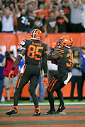 Cleveland Browns running back Carlos Hyde (34) celebrates with Cleveland Browns tight end David Njoku (85) as he celebrates after running for a third quarter touchdown that ties the score at 14-14 during the 2018 NFL regular season week 3 football game against the New York Jets on Thursday, Sept. 20, 2018 in Cleveland. The Browns won the game 21-17. (©Paul Anthony Spinelli)