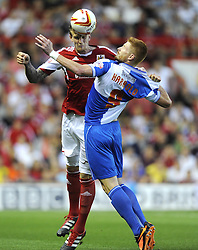 Bristol City's Aden Flint  battles for the high ball with Bristol Rovers' Matt Harrold  - Photo mandatory by-line: Joe Meredith/JMP - Tel: Mobile: 07966 386802 04/09/2013 - SPORT - FOOTBALL -  Ashton Gate - Bristol - Bristol City V Bristol Rovers - Johnstone Paint Trophy - First Round - Bristol Derby