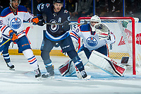 PENTICTON, CANADA - SEPTEMBER 9: Francis Beauvillier #93 of Winnipeg Jets looks for the pass as Stuart Skinner #50 of Edmonton Oilers prepares for a glove save during third period on September 9, 2017 at the South Okanagan Event Centre in Penticton, British Columbia, Canada.  (Photo by Marissa Baecker/Shoot the Breeze)  *** Local Caption ***