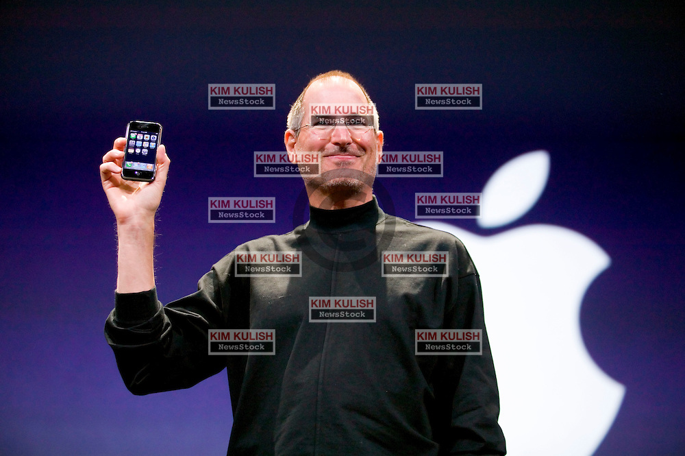 "Apple chief executive Steve Jobs unveils the ""iPhone,"" a new mobile phone that can also be used as a digital music player and a camera at the Macworld Conference in San Francisco, California.  Photo by Kim Kulish"
