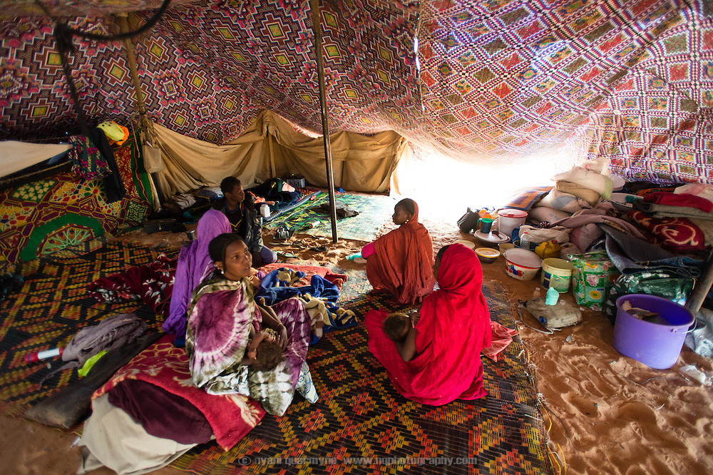 A family in their tent early in the morning at the Mbera camp for Malian refugees in Mauritania on 2 March 2013.