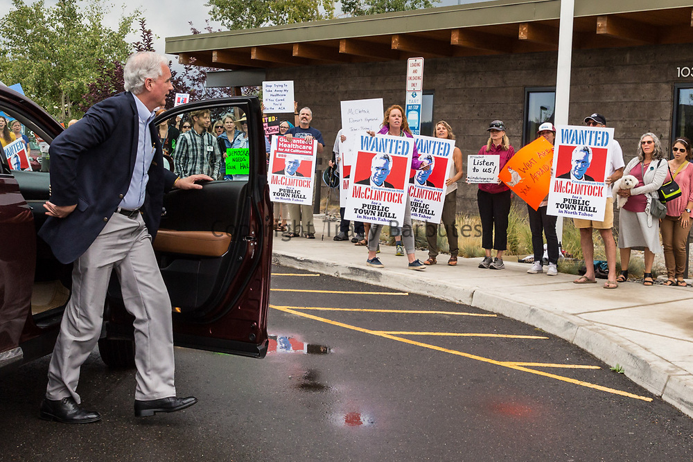 "California Congressman TOM MCCLINTOCK arrives at the Truckee Tahoe Airport for a private, closed-door meeting with the Contractors Association of Truckee Tahoe (CATT) in Truckee, California, on Tuesday, August 22, 2017. Approximately 50-60 protesters were on site. According to several local-area residents in attendance, they have been requesting a town hall meeting with McClintock for approximately two years without luck. Protester Paco Lindsay said that the protest was ""in no way a reflection at all on CATT."" McClintock represents the 4th district of California."