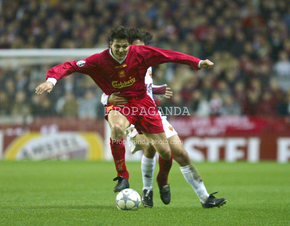 LIVERPOOL, ENGLAND - Tuesday, March 19, 2002: AS Roma's Damiano Tommasi fouls Liverpool's Jari Litamanen and concedes the free kick that Liverpool score their second goal from during the UEFA Champions League Group B match at Anfield. (Pic by David Rawcliffe/Propaganda)