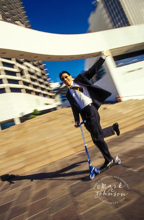 Businessman on scooter, Brisbane, Queensland, Australia