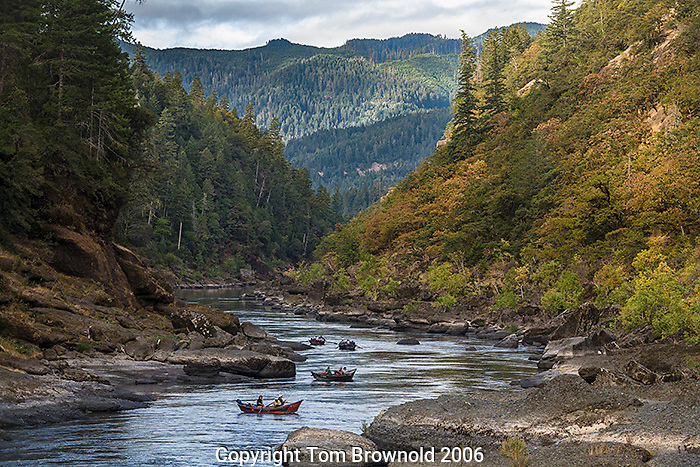 Fishermen floating down the Rogue river through the Cascade range
