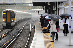 © Licensed to London News Pictures. 08/05/2014<br /> London commuters get wet this morning (08.05.2014) at Pettswood train station,Pettswood in Kent.<br /> Photo credit :Grant Falvey/LNP