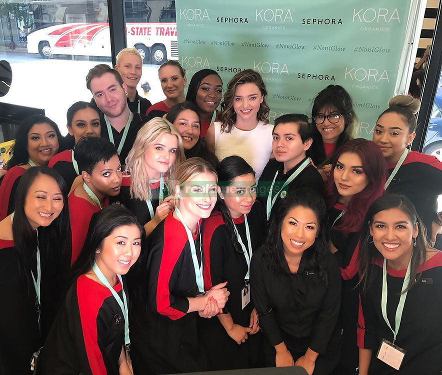"""Miranda Kerr releases a photo on Instagram with the following caption: """"Excited to kick off my first @sephora event for @koraorganics with the Chicago Michigan Ave store team! \ud83d\ude4c\ud83c\udffc\u2764\ufe0f\u2728 #FabMichAve #SephoraLovesKora #noniglow"""". Photo Credit: Instagram *** No USA Distribution *** For Editorial Use Only *** Not to be Published in Books or Photo Books ***  Please note: Fees charged by the agency are for the agency's services only, and do not, nor are they intended to, convey to the user any ownership of Copyright or License in the material. The agency does not claim any ownership including but not limited to Copyright or License in the attached material. By publishing this material you expressly agree to indemnify and to hold the agency and its directors, shareholders and employees harmless from any loss, claims, damages, demands, expenses (including legal fees), or any causes of action or allegation against the agency arising out of or connected in any way with publication of the material."""