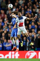 Chelsea Defender David Luiz (BRA) and PSG Midfielder Lucas (BRA) compete in the air - Photo mandatory by-line: Rogan Thomson/JMP - 07966 386802 - 08/04/2014 - SPORT - FOOTBALL - Stamford Bridge, London - Chelsea v Paris Saint-Germain - UEFA Champions League Quarter-Final Second Leg.