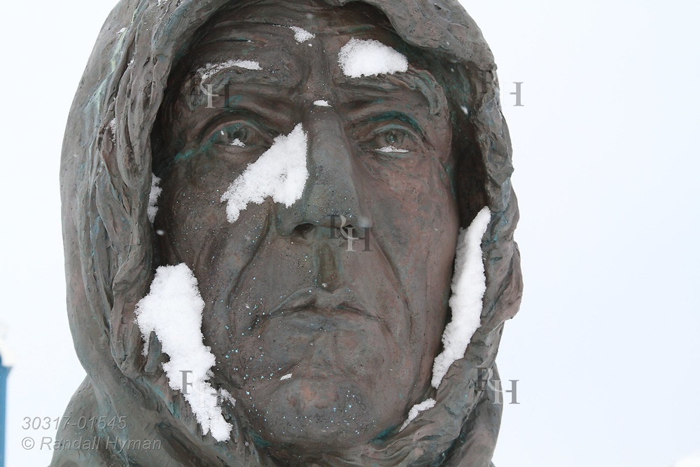 Statue of Roald Amundsen, Norwegian polar explorer, stands in center of the international science village of Ny-Alesund on Spitsbergen island in Kongsfjorden; Svalbard, Norway.