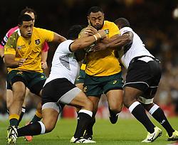 Fiji Hooker Talemaitoga Taupati tackles Australia Prop Sekope Kepu  - Mandatory byline: Joe Meredith/JMP - 07966386802 - 23/09/2015 - Rugby Union, World Cup - Millenium Stadium -Cardiff,Wales - Australia v Fiji - Rugby World Cup 2015 - Pool A