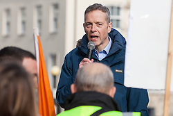 Maidenhead, UK. 23rd February, 2019. Matt Rodda, Labour MP for Reading East, addresses members of the Windsor and Maidenhead branches of the Labour Party and UNISON and GMB trade unions at a protest outside Maidenhead Town Hall in Prime Minister Theresa May's constituency against planned spending cuts of £6.8m to the 2019/2020 budget by the Royal Borough of Windsor and Maidenhead. Over 1,000 people had signed a petition to the council demanding an alternative to the cuts.