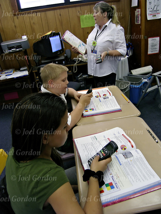 6th Grade Gifted and Talented Advanced Math.  This class is comprised of a 51% gifted and 49% talented population. It is an advanced math curriculum which goes quicker and covers times not covered in the general population.  We were working on theoretical probability on the day you filmed. Students were using an electronic device referred to as ?responders?. The responder allows the student to respond to a question asked from the teacher and records all of the responses into a computer. The teacher is then able to determine who is or is not having difficulty on the spot vs. trying to get to everyone?s papers. It also keeps students engaged. All responses need to be in before the teacher divulges the answer.