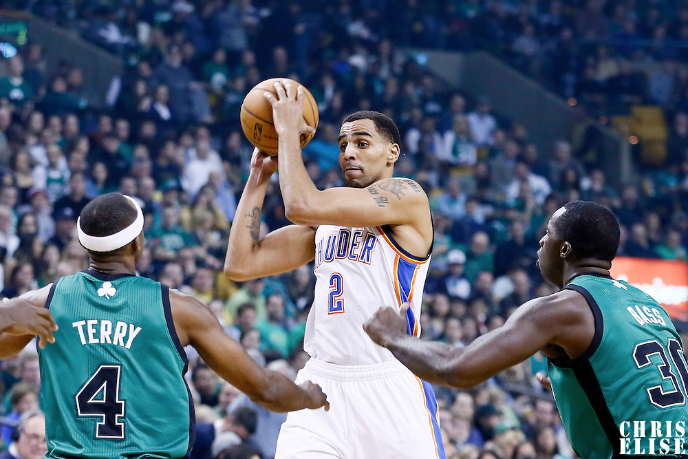 23 November 2012: Oklahoma City Thunder shooting guard Thabo Sefolosha (2) looks to pass the ball during the Boston Celtics 108-100 victory over the Oklahoma City Thunder at the TD Garden, Boston, Massachusetts, USA.