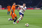Netherlands forward Memphis Depay (Olympique Lyonnais),battles with England midfielder Jordan Henderson during the Friendly match between Netherlands and England at the Amsterdam Arena, Amsterdam, Netherlands on 23 March 2018. Picture by Phil Duncan.