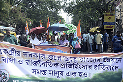 April 3, 2017 - Kolkata, West Bengal, India - TMC activist rallued wuth placard and shout slogan against Union Government.South Kolkata Trinamool Congress  Yuva Commitee holds a rally protesting against Union Government?s economic deprivation and demanding arrest of B.J.P, Congress and C.P.I.(M) leaders involving in Narada, Sarada and other chit fund scam in Kolkata. (Credit Image: © Saikat Paul/Pacific Press via ZUMA Wire)
