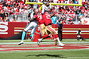 San Francisco 49ers cornerback Dontae Johnson (36) defends Carolina Panthers wide receiver Kelvin Benjamin (13) as San Francisco 49ers free safety Jaquiski Tartt (29) leaps and makes a one-handed interception of an end zone pass and returns it 37 yards to the Niners 38 yard line in the second quarter during the 2017 NFL week 1 regular season football game against the Carolina Panthers, Sunday, Sept. 10, 2017 in Santa Clara, Calif. The Panthers won the game 23-3. (©Paul Anthony Spinelli)