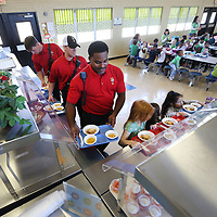 Adam Robison | BUY AT PHOTOS.DJOURNAL.COM<br /> Tupelo firefighers Justin Lamb, captain, James Roberts and Sidney Jones, go through the lunch line with the students at ECEC on Friday. The Tupelo Fire Department has started a new program. The firemen on shift go eat lunch at lower elementary schools to give kids a chance to see firemen are their friends.