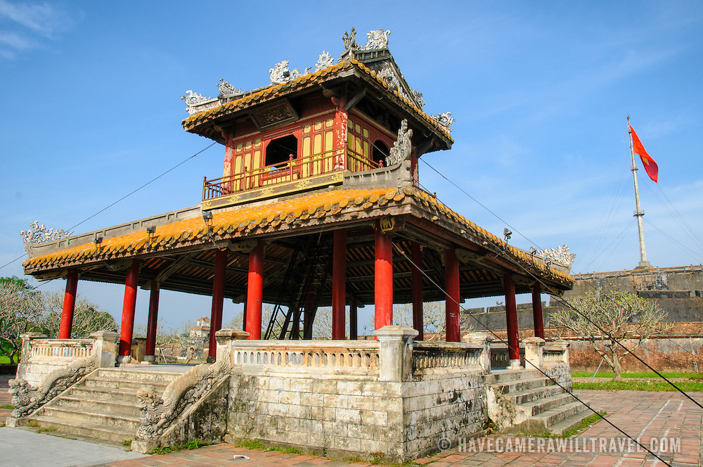 A pagoda across the moat at the Imperial City in Hue, Vietnam. A self-enclosed and fortified palace, the complex includes the Purple Forbidden City, which was the inner sanctum of the imperial household, as well as temples, courtyards, gardens, and other buildings. Much of the Imperial City was damaged or destroyed during the Vietnam War. It is now designated as a UNESCO World Heritage site.