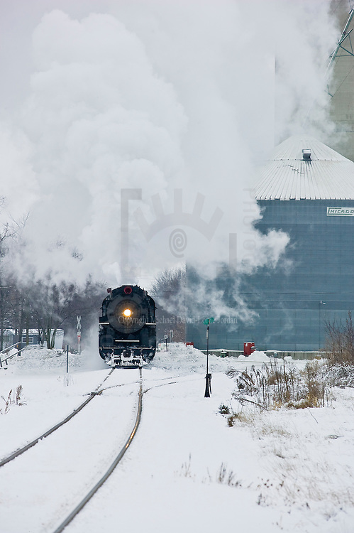"1225 Pere Marquette steam locomotive under power pulling a ""North Pole Express "" passenger train."