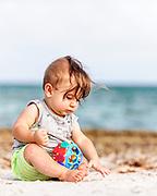 Lucas exploring the beach sand.