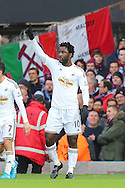 Wilfried Bony of Swansea City celebrates after scoring the opening goal of the Barclays Premier League match against West Ham United at the Boleyn Ground, London<br /> Picture by Richard Calver/Focus Images Ltd +447792 981244<br /> 07/12/2014