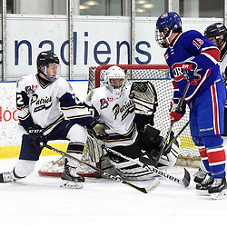 TORONTO, ON  - NOV 26,  2017: Ontario Junior Hockey League game between the Toronto Jr. Canadiens and the Toronto Patriots, Ryan Wells #22 and Tyler Fassel #30 of the Toronto Patriots try to keep the puck from Matthew O'Brien #16 of the Toronto Jr. Canadiens during the second period.<br /> (Photo by Andy Corneau / OJHL Images)