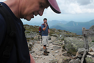 John Walcott, foreground, has his picture taken by his son-in-law, Jared Leonard, three tenths of a mile from the summit of Mt Katahdin in Maine's Baxter State Park.  A group of family and friends was climbing with Walcott to celebrate his 60th birthday.  Walcott has been climbing Mt Katahdin, the highest peak in Maine and the northern terminus of the Appalachian Trail, since 1976.
