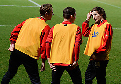 © London News Pictures. 26/02/2014. Doncaster, UK. One Directions Louis Tomlinson (R) warms up with team mates ahead of his debut for Doncaster reserves against Rotherham at the Keepmoat Stadium in Doncaster 26 February 2014 . Photo credit: London News Pictures.