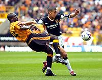 Photo: Ed Godden/Sportsbeat Images.<br />Wolverhampton Wanderers v Hull City. Coca Cola Championship. 09/04/2007. Wolves' Seyi Olofinjana (L), is beaten to the ball by Lee Peltier.
