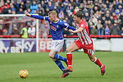 Accrington Stanley Sean McConville and Carlisle United Nicky Adams battle during the EFL Sky Bet League 2 match between Accrington Stanley and Carlisle United at the Fraser Eagle Stadium, Accrington, England on 21 January 2017. Photo by Pete Burns.