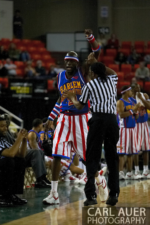 """05 May 2006: Kevin """"Special K"""" Daley struggles with a referee over a fans stolen purse during the Harlem Globetrotters vs the New York Nationals at the Sulivan Arena in Anchorage Alaska during their 80th Anniversary World Tour."""