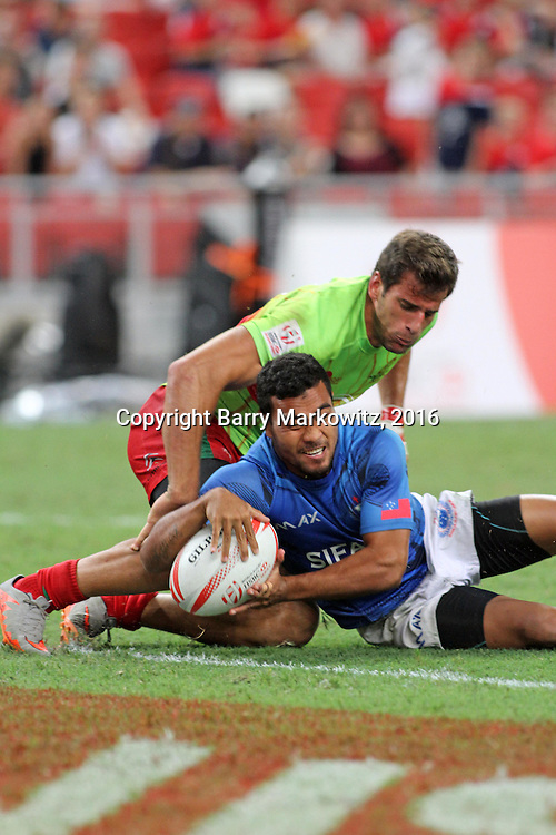 Samoa Toloa scores a second half try in Manu Samoa's 28-12 victory over Portugal to earn a Quarter Final Cup slot vs Argentina in day two.  Singapore 7's, Singapore National Stadium, Singapore.  Photo by Barry Markowitz, 4/16/16