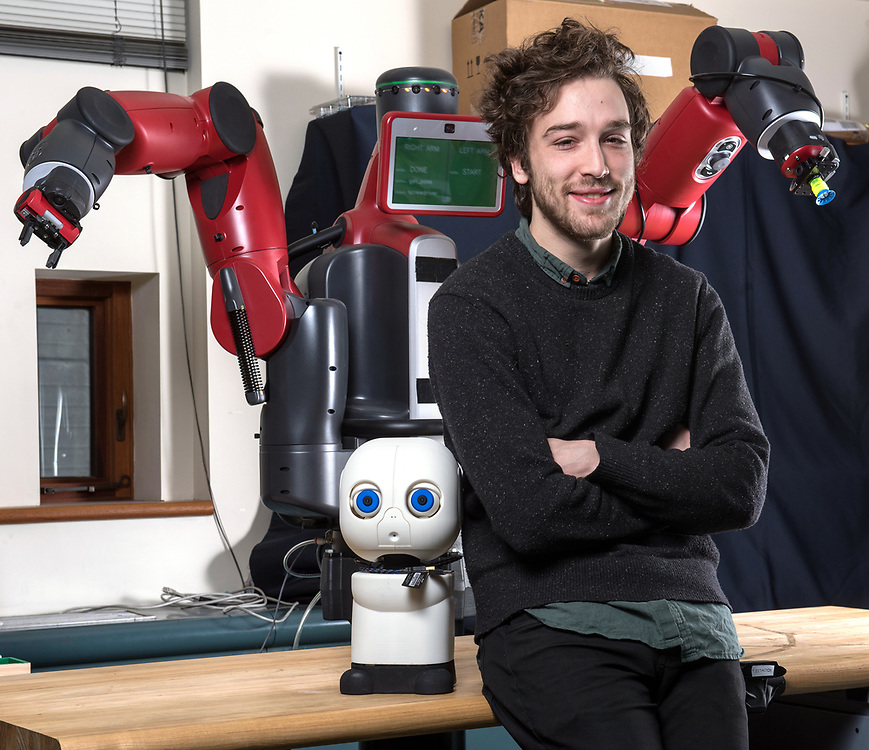 Photo by Mara Lavitt<br /> New Haven, CT<br /> January 26, 2017<br /> Yale PHD student Jake Brawer with his MAKI robot (the small, white one) in the Yale Social Robotics Lab in Arthur K. Watson Hall. Brawer's MAKI assists in teaching sign language to infants with deafness.