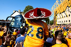 Wolverhampton Wanderers fan wears a sombrero as Joao Moutinho of Wolverhampton Wanderers - Mandatory by-line: Robbie Stephenson/JMP - 25/08/2019 - FOOTBALL - Molineux - Wolverhampton, England - Wolverhampton Wanderers v Burnley - Premier League