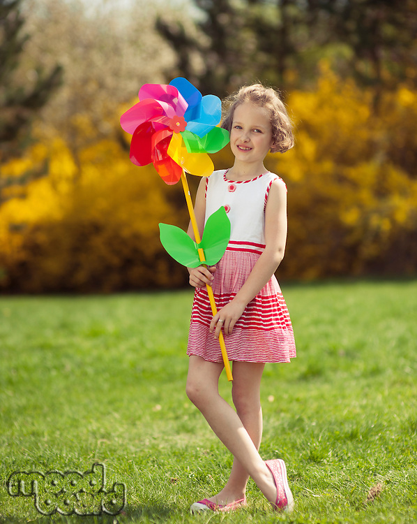 Young girl holding large Flower shaped wind wheel