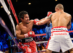 Manny Pacquiao of the Philippines trades with  Miguel Angel Cotto of Puerto Rico in their WBO Welterweight Championship fight at the MGM Grand Garden Arena on November 14, 2009 in Las Vegas, Nevada. Pacquiao won his seventh world title in as many divisions