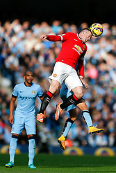 Wayne Rooney of Manchester United and Jesus Navas of Manchester City compete in the air - Photo mandatory by-line: Rogan Thomson/JMP - 07966 386802 - 02/11/2014 - SPORT - FOOTBALL - Manchester, England - Etihad Stadium - Manchester City v Manchester United - Barclays Premier League.