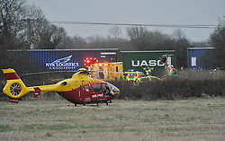 © Licensed to London News Pictures. 2/1/2013. An air ambulance and emergency services at the scene where a man died when his car is hit by a freight train on a level crossing on Sandy Lane between Yarnton and Kidlington in Oxfordshire. The man was declared dead at the scene. Photo credit: MarkHemsworth/LNP