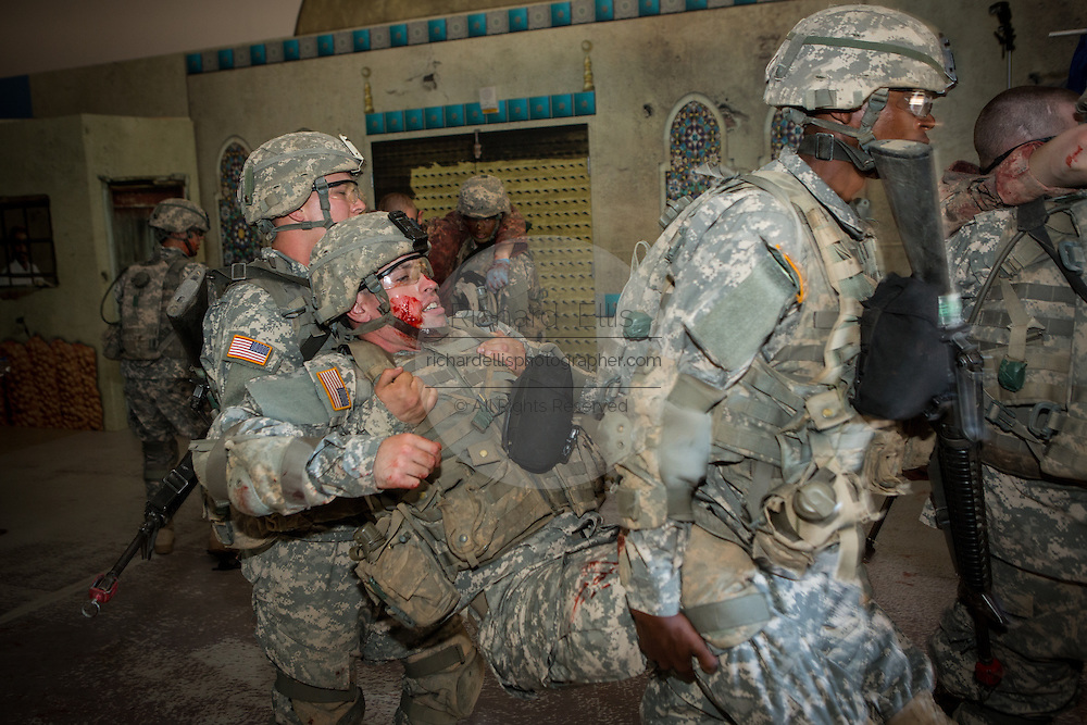 US Army soldiers during combat medical simulation at basic combat training during boot camp at Fort Jackson September 27, 2013 in Columbia, SC.