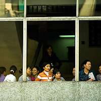 A migrant workers look through a factory&acute;s window in China&acute;s souther region of Canton, where thousands of people has lost their jobs in the last months. Zhenshen, China. November 26, 2008/ Photographer: Bernardo De Niz<br /> China is facing a difficult employment situation in 2009 as the global financial crisis impacs on the country&acute;s economy.<br /> Accorgin to the Ministry of human resources and Social Security, China&acute;s urban registered unemploment rate climbed to 4.2 percen in December 2008. It&acute;s highest level in 5 years, with an estimated 20 millions migrant workers reportered to have lost their jobs.