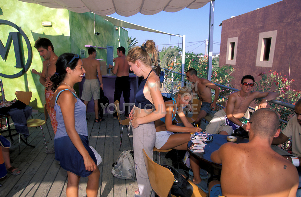 A group of people relax in the V.I.P area in a club in Ibiza, 2000's.