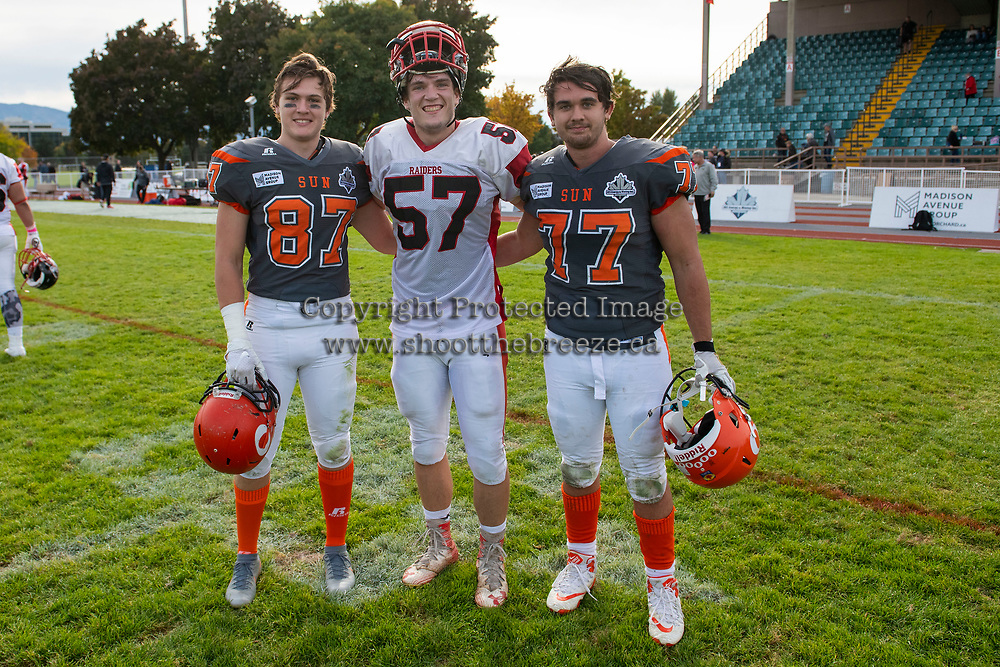 KELOWNA, BC - OCTOBER 6: Kaden Wagner #87 and Josh Keen #77 of Okanagan Sun pose for a photo with Zack Willis #57 of the VI Raiders at the Apple Bowl on October 6, 2019 in Kelowna, Canada. (Photo by Marissa Baecker/Shoot the Breeze)