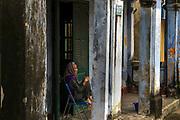 Lady on her verandah